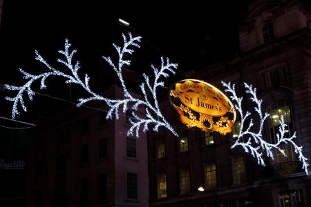 regent: LONDON - NOVEMBER 14: Christmas lights on Regent Street on November 14, 2012 in London. Christmas lights tradition began on Regent Street in 1954.