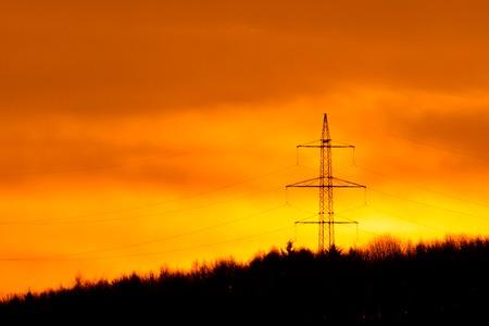 over the hill: La salida del sol de oro sobre colina con poste de electricidad Foto de archivo