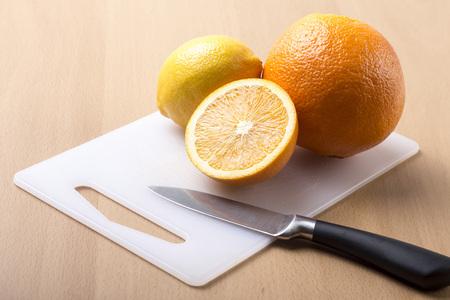 sliced orange: Sliced orange on wooden background - horizontal image