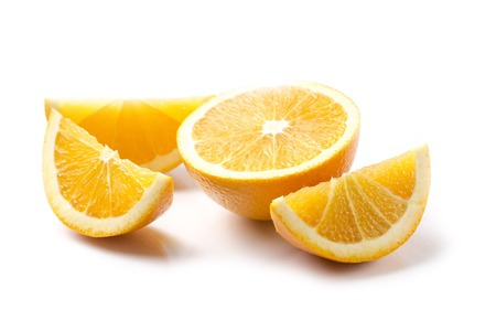orange color: Sliced orange on white background - horizontal image