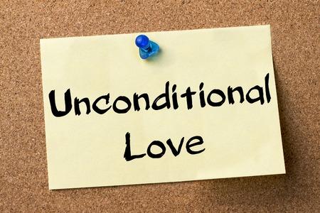 feel feeling: Unconditional Love - adhesive label pinned on bulletin board - horizontal image Stock Photo