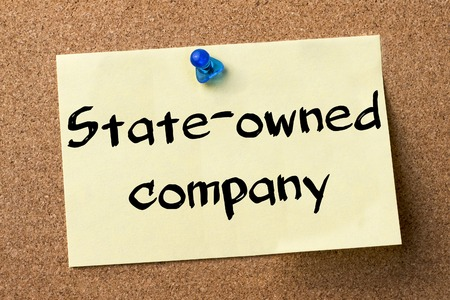 state owned: State-owned company - adhesive label pinned on bulletin board - horizontal image