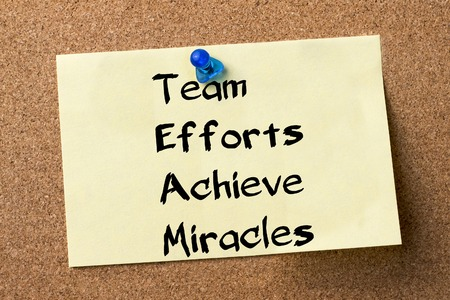 efforts: Team Efforts Achieve Miracles - adhesive label pinned on bulletin board - horizontal image