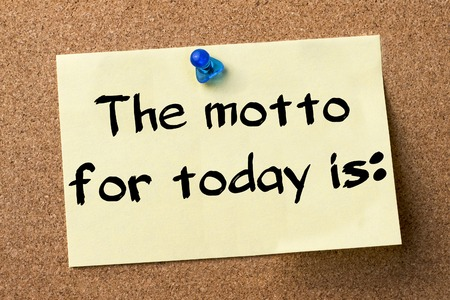 motto: The motto for today is: - adhesive label pinned on bulletin board - horizontal image
