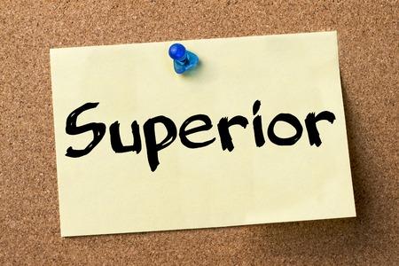 superior: Superior - adhesive label pinned on bulletin board - horizontal image Stock Photo