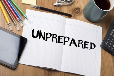 unprepared: UNPREPARED - Note Pad With Text On Wooden Table - with office  tools Stock Photo