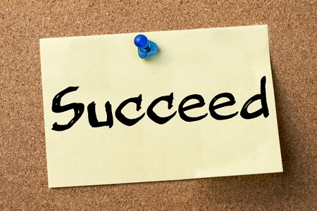 succeed: Succeed - adhesive label pinned on bulletin board - horizontal image