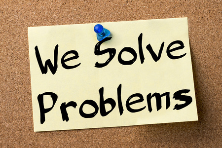 solve problems: We Solve Problems - adhesive label pinned on bulletin board - horizontal image
