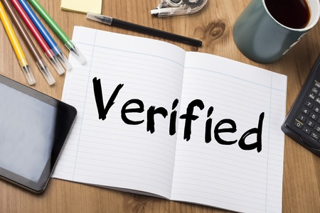 verified: Verified - Note Pad With Text On Wooden Table - with office  tools