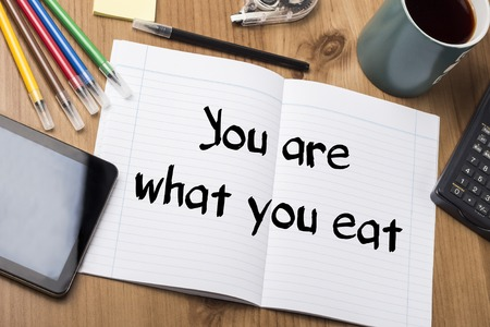 what to eat: You are what you eat - Note Pad With Text On Wooden Table - with office  tools