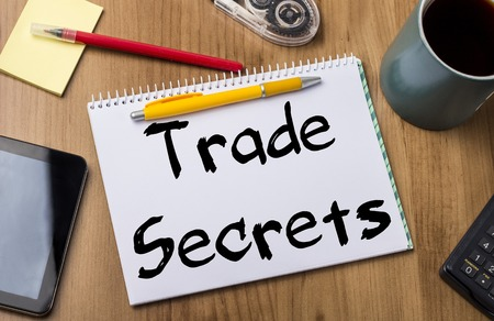 trade secret: Trade Secrets - Note Pad With Text On Wooden Table - with office  tools Stock Photo