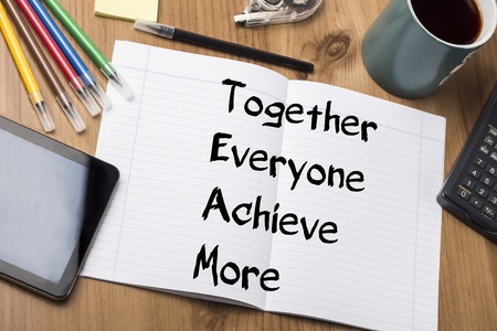 everyone: Together Everyone Achieve More TEAM - Note Pad With Text On Wooden Table - with office  tools Stock Photo