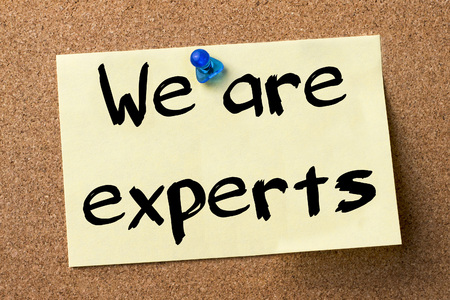 job posting: We are experts - adhesive label pinned on bulletin board - horizontal image