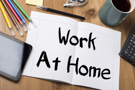 work from home: Work At Home - Note Pad With Text On Wooden Table - with office  tools Stock Photo