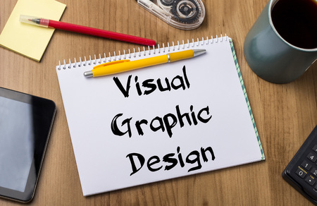 note pad and pen: Visual Graphic Design - Note Pad With Text On Wooden Table - with office  tools