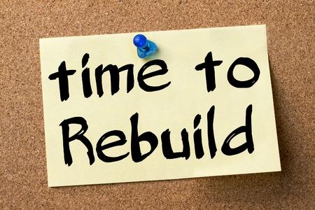 rebuild: Time to Rebuild - adhesive label pinned on bulletin board - horizontal image