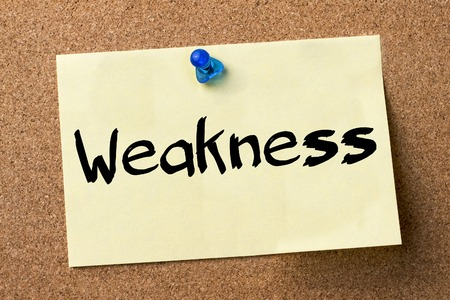 weakness: Weakness - adhesive label pinned on bulletin board - horizontal image