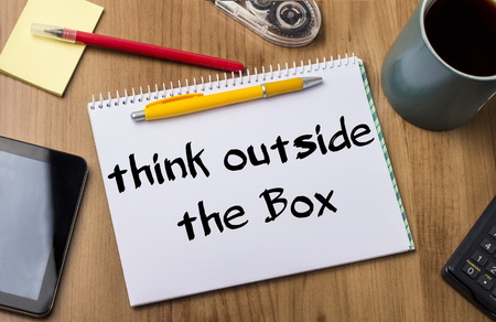 text box: Think Outside the Box - Note Pad With Text On Wooden Table - with office  tools