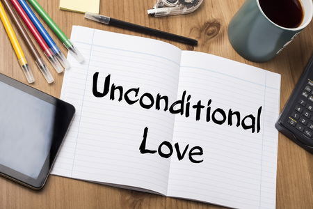 feel feeling: Unconditional Love - Note Pad With Text On Wooden Table - with office  tools