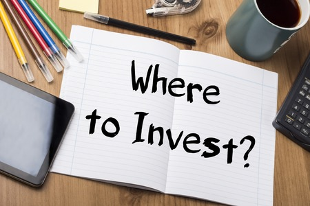 where: Where to Invest? - Note Pad With Text On Wooden Table - with office  tools Stock Photo
