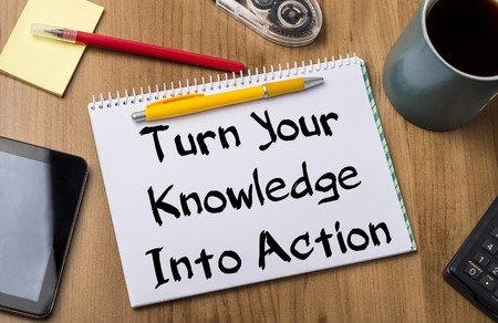 turn table: Turn Your Knowledge Into Action - Note Pad With Text On Wooden Table - with office  tools Stock Photo