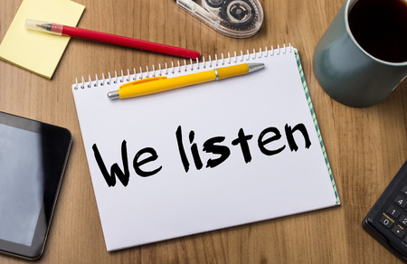 We listen - Note Pad With Text On Wooden Table - with office  tools