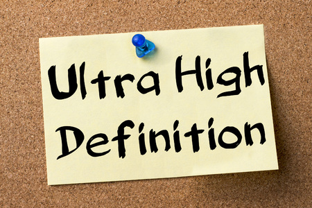 definition high: Ultra High Definition - adhesive label pinned on bulletin board - horizontal image Stock Photo