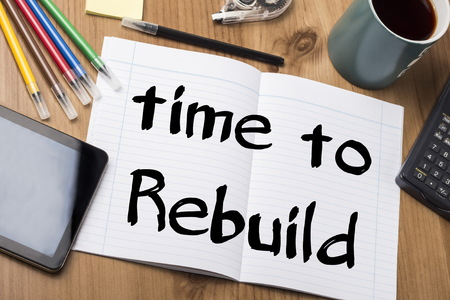 rebuild: Time to Rebuild - Note Pad With Text On Wooden Table - with office  tools