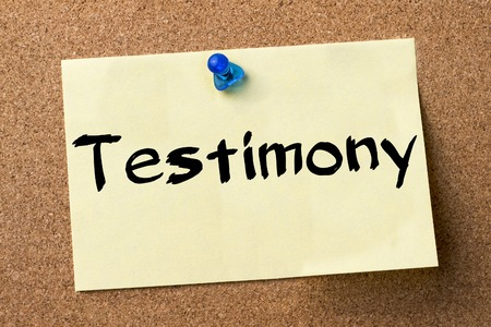 Testimony - adhesive label pinned on bulletin board - horizontal image Stock Photo
