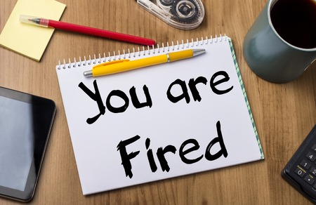you are fired: You are Fired - Note Pad With Text On Wooden Table - with office  tools Stock Photo