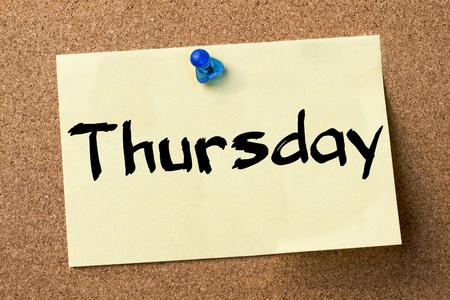 thursday: Thursday - adhesive label pinned on bulletin board - horizontal image