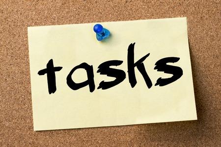 tasks: tasks - adhesive label pinned on bulletin board - horizontal image