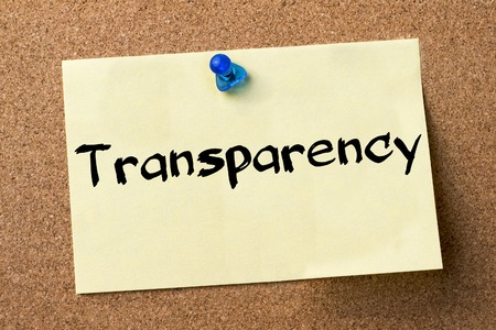 bulletin: Transparency - adhesive label pinned on bulletin board - horizontal image
