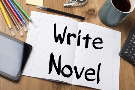 novel: Write Novel - Note Pad With Text On Wooden Table - with office  tools Stock Photo