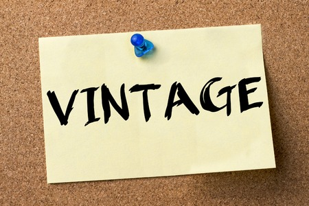 pin board: VINTAGE - adhesive label pinned on bulletin board - horizontal image Stock Photo