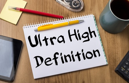 definition high: Ultra High Definition - Note Pad With Text On Wooden Table - with office  tools