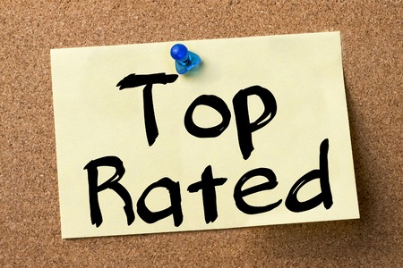 rated: Top Rated - adhesive label pinned on bulletin board - horizontal image