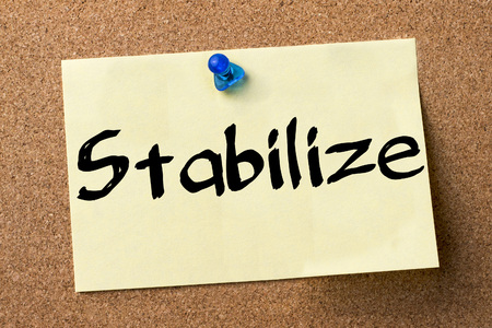 stabilize: Stabilize - adhesive label pinned on bulletin board - horizontal image