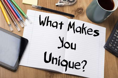 note pad: What Makes You Unique? - Note Pad With Text On Wooden Table - with office  tools