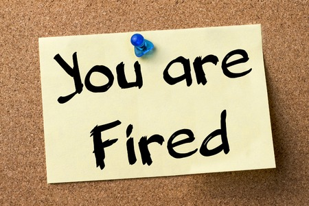 you are fired: You are Fired - adhesive label pinned on bulletin board - horizontal image