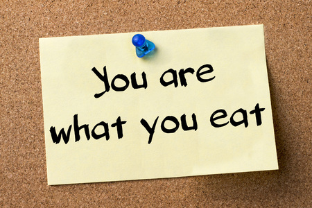 what to eat: You are what you eat - adhesive label pinned on bulletin board - horizontal image Stock Photo