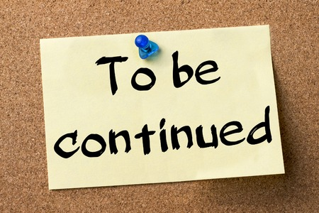 continued: To be continued - adhesive label pinned on bulletin board - horizontal image Stock Photo