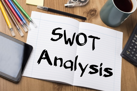 swot analysis: SWOT Analysis - Note Pad With Text On Wooden Table - with office  tools