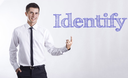 Identify - Young smiling businessman pointing on text - horizontal images