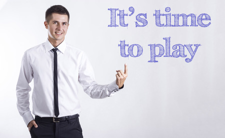 time to play - Young smiling businessman pointing on text - horizontal images