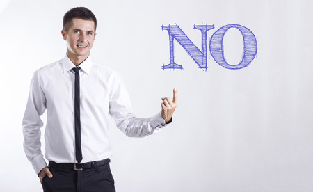 NO - Young smiling businessman pointing on text - horizontal images Stok Fotoğraf