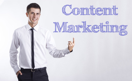Content Marketing - Young smiling businessman pointing on text - horizontal images Stok Fotoğraf
