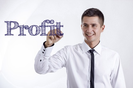 Profit - Young smiling businessman writing on transparent surface - horizontal images