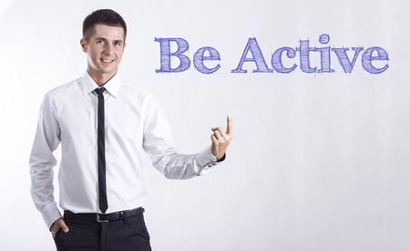 Be Active - Young smiling businessman pointing on text - horizontal images Stok Fotoğraf