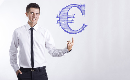 Euro sign - Young smiling businessman pointing on text - horizontal images